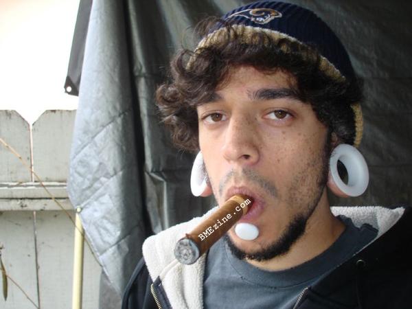 Pierced guy in tats yanking his dick
